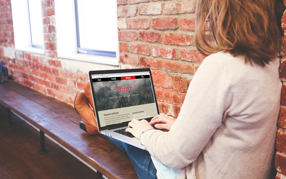 De website van REDFOX op een laptop